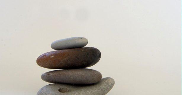 balanced-stones-on-white-background